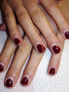 the reverse french manicure gives these simple shades an unexpected twist