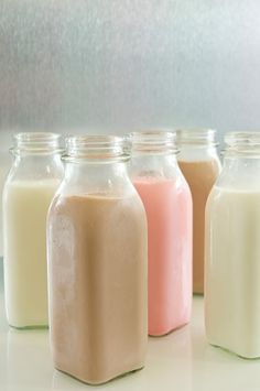 I know mason jars are so hot right now, but I would rather do something with milk bottles....love.