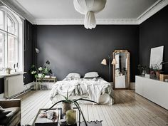 This Small, Dark-Walled Studio Apartment is Proof that Rules are Made to Be Broken