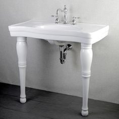 This Imperial Vintage white bathroom sink vanity features cleanlines and a crisp, classic white color to match any decor.Constructed of stain- and germ-resistant vitreous china material,this pedestal