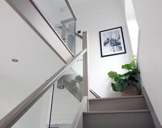Do you ever wonder how a staircase can be transformed in 48 hours without any structural work required? Watch our team hard at work with the installation of this Grey Wash Oak and embedded glass balustrade Staircase Renovation. Glass Stairs Design, Home Stairs Design, Home Interior Design, Painted Staircases, Painted Stairs, House Staircase, Oak Stairs, Hallway Inspiration, Hallway Designs