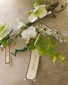 These homemade silk-flower boutonnieres with green flourishes were made by the bride