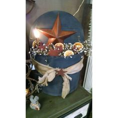 Large cheese box decorated with pip berries, stars, and electric silicone bulb candle. $39.99