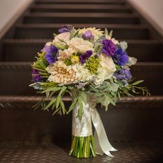 Purple, ivory and blue bouquet // Robert Norman Photography // Hana Floral Design // http://www.theknot.com/weddings/album/a-vintage-vineyard-wedding-in-stonington-ct-133895
