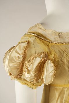Ball gown. British, 1811. Met Museum, C.I.66.38 1a, b. Looks like silk gauze, over silk satin. Note yellow lace.