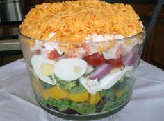 Yum... I'd Pinch That! | Pretty layered salad. The ingredients are so good. This salad is perfect for dinners, formal or informal!