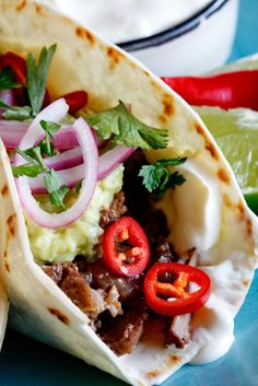 Slow-braised short rib tacos with quick-pickled red onion - oh-so-good - browned the short ribs first and added an ancho chili