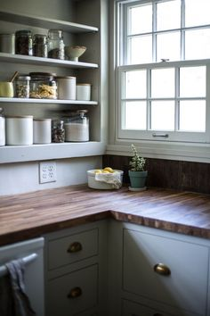The counters are butcher block from Lumber Liquidators. Catskills-Farmhouse-kitchen-by-Jersey-Ice-Cream-Co-Remodelista-3
