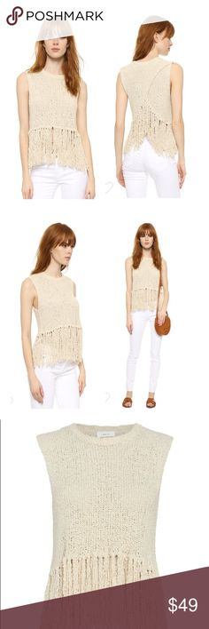 A.L.C Dylan Top Unique, fringed yarn composes this tactile A.L.C. crop top. Crossover back panels offer a breezy element, and long fringe lends a rustic finish. Sleeveless. Semi-sheer.  Fabric: Tactile knit. 96% silk/2% rayon/1% wool/1% other fibers. Hand wash or dry clean. Imported, China. Fabric from Italy.  Measurements Length 1: 15in / 38cm, from shoulder to hem Length 2: 22in / 56cm, from shoulder to end of fringe Measurements from size Xs Gently worn, no stains or holes A.L.C. Tops