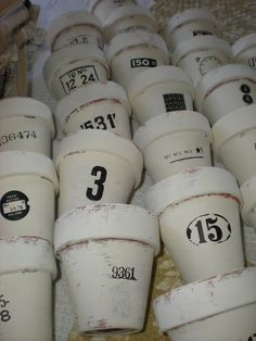 Chalk painted terra cotta pots with rub-on transfer vintage graphics