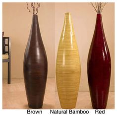 @Overstock.com.com - Handcrafted Bamboo Floor Vase and Branches - This bamboo floor vase is handcrafted from natural bamboo and comes in a choice of a red or brown finish. This vase comes with assorted dried botanicals already in place, making this an easy and elegant way to bring a bit of nature indoors.  http://www.overstock.com/Home-Garden/Handcrafted-Bamboo-Floor-Vase-and-Branches/5500791/product.html?CID=214117 $97.99