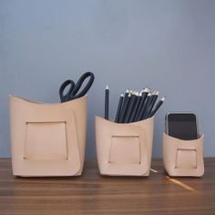Leather storage bins