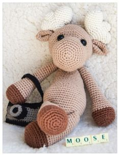 Moose with camera - crochet Pattern from Ravelry for $4 it does not include the camera though!