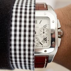 Cartier watch. The link doesn't go anywhere, but the watch looks awesome.