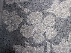 Flower design made from tiny pebbles on a pathe in Bali. Click to see more http://www.ninadesigns.com/blog/category/bali/ #bali #travel