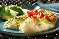 Top haddock fillets with MIRACLE WHIP dressing, pesto, chopped tomatoes—and voilà! You've got this Creamy Pesto Fish, ready to please four lucky diners. Baked Haddock Recipes, Pork Recipes, Fish Recipes, Seafood Recipes, Kraft Foods, Kraft Recipes, Seafood Dinner, Fish And Seafood, Goya Recipe
