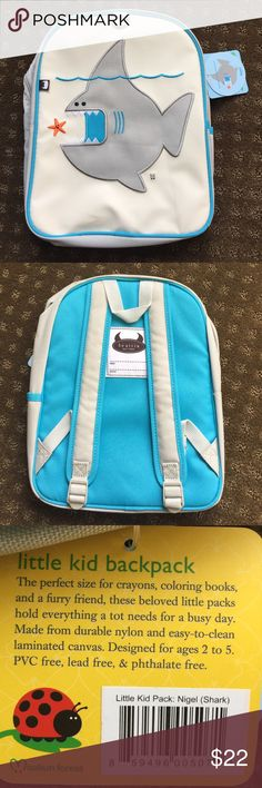 Beatrix NY Little Kids Pack Shark Beautifully embroidered, adorable shark backpack holds everything a tot needs for a busy day. Constructed from durable nylon and wipeable laminated canvas. Roomy interior contains a smaller zipped pocket. Comfy padded back panel and padded shoulder straps. Designed for children ages 2 to 4. PVC free, lead free, phthalate free & BPA free. Can machine wash •  Measurement size (inches): 9l x 12h x 5.5w Other