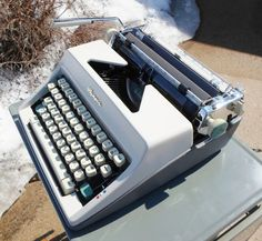 Vintage Olympia De Luxe Manual Typewriter, Portable, Off White, Green and Grey, Mad Men, Mid Century Modern, Made in Western Germany. $135.00, via Etsy.