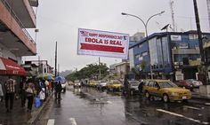Banner in Monrovia, Liberia, warns people to be cautious about the ebola virus. This photo was chosen because it shows that the situation is current and even in the midst of a special day for the country, the deadliness of the disease is real and alive. http://www.theguardian.com/world/2014/jul/30/ebola-outbreak-pan-african-airline-halts-flights-liberia-sierra-leone
