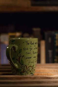 J.R.R. Tolkien The Road goes ever on and on LOTR Literary quote mug - Medium-large hunter green mug with vines. $16.00, via Etsy.