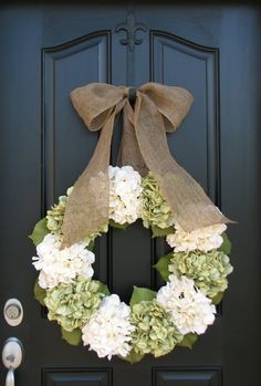 Spring Wreaths- love the simple green and ivory color scheme with the burlap bow