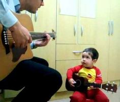 Two year old Diogo Mello and his father sing and play The Beatles classic 'Don't Let Me Down'.