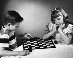 Children playing checkers. Ahhh, days gone by. #nostalgia ( ''Crown me '' ) then pieces can go both ways / I knew game as 'draughts ' Americans call game checkers as checkered squares on board n paid for by Dads pay cheque ?