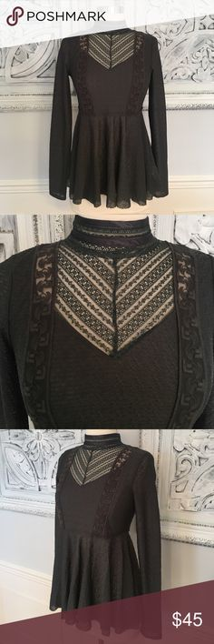 Free people high neck peplum top! NWOT. Excellent condition! Free people high neck lace detail peplum top. Keyhole back. Charcoal grey. Size small. 95% polyester 5% spandex gives for a nice amount of stretch. So cute! Smoke free, clean home! Free People Tops Blouses