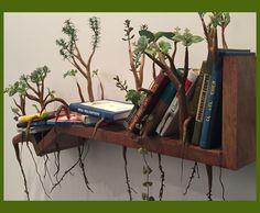 Livros criando raízes na estante, de Camille Kachani - imagem linda, né?