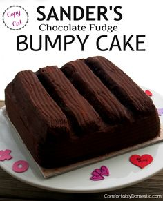 Copy Cat Sanders Bumpy Cake is deliciously soft and scrumptious buttermilk chocolate cake that is topped with cream filling and coated in pourable fudge. A homemade version of the iconic (originall...