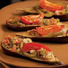 These stuffed eggplants are filled with peppers, onion, garlic and tomatoes.  @eatingwell #vegan