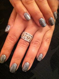 silver gel manicure with glitter gel overlay  Nails by Patty