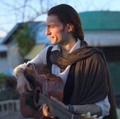 Estas Tonne, Guitarist and Traveler