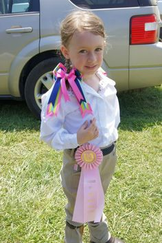 Horse show bows on a cute lead line rider.