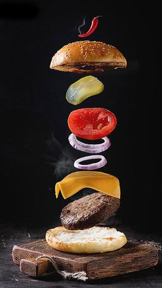 Flying ingredients for homemade burger on little wooden cutting board over dark … Flying ingredients for homemade burger on little wooden cutting board over dark background. Food Photography Styling, Food Styling, Food Design, Homemade Burgers, C'est Bon, Food Menu, Creative Food, Food Truck, Food Pictures