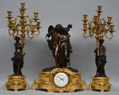 Lot 723: A rich patinated and gilt bronze Neoclassical mantel clock with garniture, the clock depicting an allegory on love and fidelity, the dial is marked 'Deniere Société de Bronze à Paris', H 66,5 - W 55,5 (clock) / H 85 cm (garnitures)  € 5.000 - € 8.000
