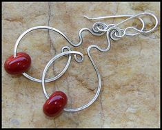 Artisan lampwork glass beads in sleek red on oxidized and hammered sterling silver wire. #SterlingSilverWire