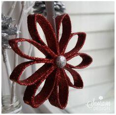 Rød julestjerne i glitter - Red christmas star in glitter.