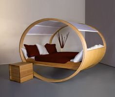 A smaller version for a living area, or putting rails on the sides and making it the size of a cradle would be cool.