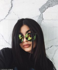 Here's looking at you: The youngest daughter of momager Kris Jenner rocked a pair of funky aviator shades in this snap posted to her Instagram Saturday