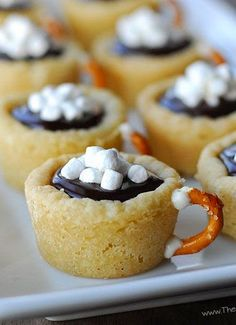 This easy cookie recipe for Hot Chocolate Cookie Cups is made with Pillsbury Sugar Cookie dough. They're filled with chocolate ganache and have a pretzel handle! These Hot Chocolate Cookie Cups were amazing! Holiday Baking, Christmas Desserts, Christmas Baking, Holiday Treats, Holiday Recipes, Cute Christmas Cookies, Christmas Recipes, Easy Christmas Treats, Winter Treats