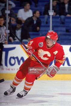Canadian hockey player Theo Fleury of the Calgary Flames on the ice during a game, early 1990s.