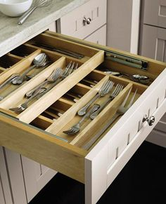 Keep your everyday flatware and your entertaining silverware well organized and in the same drawer with a sliding top tier tray.