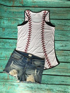Black racerback tank top. Tank has baseball thread design on top shoulder and entire back side. So cute!!! **Baseball Aunt and Baseball Stepmom also available. Just let me know in the Notes to Seller. Choose between the following designs: 1 - Baseball mom 2 - Script love Design 3 -
