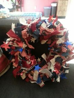 Fourth of July wreath easy as pie Get fabric garland from Michaels, a grape vine wreath from the dollar store, and some sparkling stars. Wrap and pin down with needle pins. Presto ur done