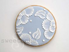 Brush embroidery is one of my favorite decorating techniques. For a list of suppliesused in this and other tutorials, click here.        To begin, fill a decorating bag fitted with a tip 3 with thinned blue icing. The color shown here is Wilton