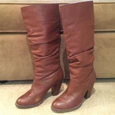 Brown Leather Boots Brown leather boots with scrunched look. Both boots have scuff marks on the inside of boot and other signs of wear. Heel is 3.5 inches and has a wooden look. Boots measure 18 inches tall from floor. Zodiac Shoes