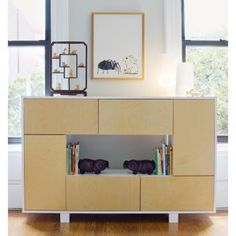 """Nicely done toy cupboard in birch and white for modern kids and parents, who now realize that the kids want to play by you, not in their room.  Make your whole house modern-kid-friendly.  """"Eiffel"""" bookcase by Arginton."""
