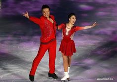Chinese skaters Shen Xue (R) and Zhao Hongbo perform during the opening ceremony of the ISU World Figure Skating Championships 2015 at Crown Indoor Stadium, Oriental Sports Center in Shanghai, China, on March 25, 2015