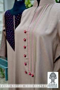 V Luv Fash!on: Zahra Khayyam Casual Shirts & Kurta's Collection 2013 For WomenZahra Khayyam is an upcoming fashion designer of Pakistan who is serving her consumers since She provides women with the latest an.Earthy color with red buttons Neck Designs For Suits, Dress Neck Designs, Designs For Dresses, Blouse Designs, Sleeve Designs, Salwar Designs, Kurta Designs Women, Kurta Patterns, Kurti Embroidery Design